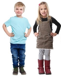 Young boy in blue and young girl in pinafore dress