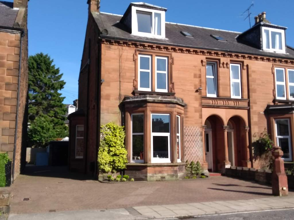 External view of Lindean Guest House Dumfries, a Victorian red sandstone villa in a quiet residential street near the railway station.