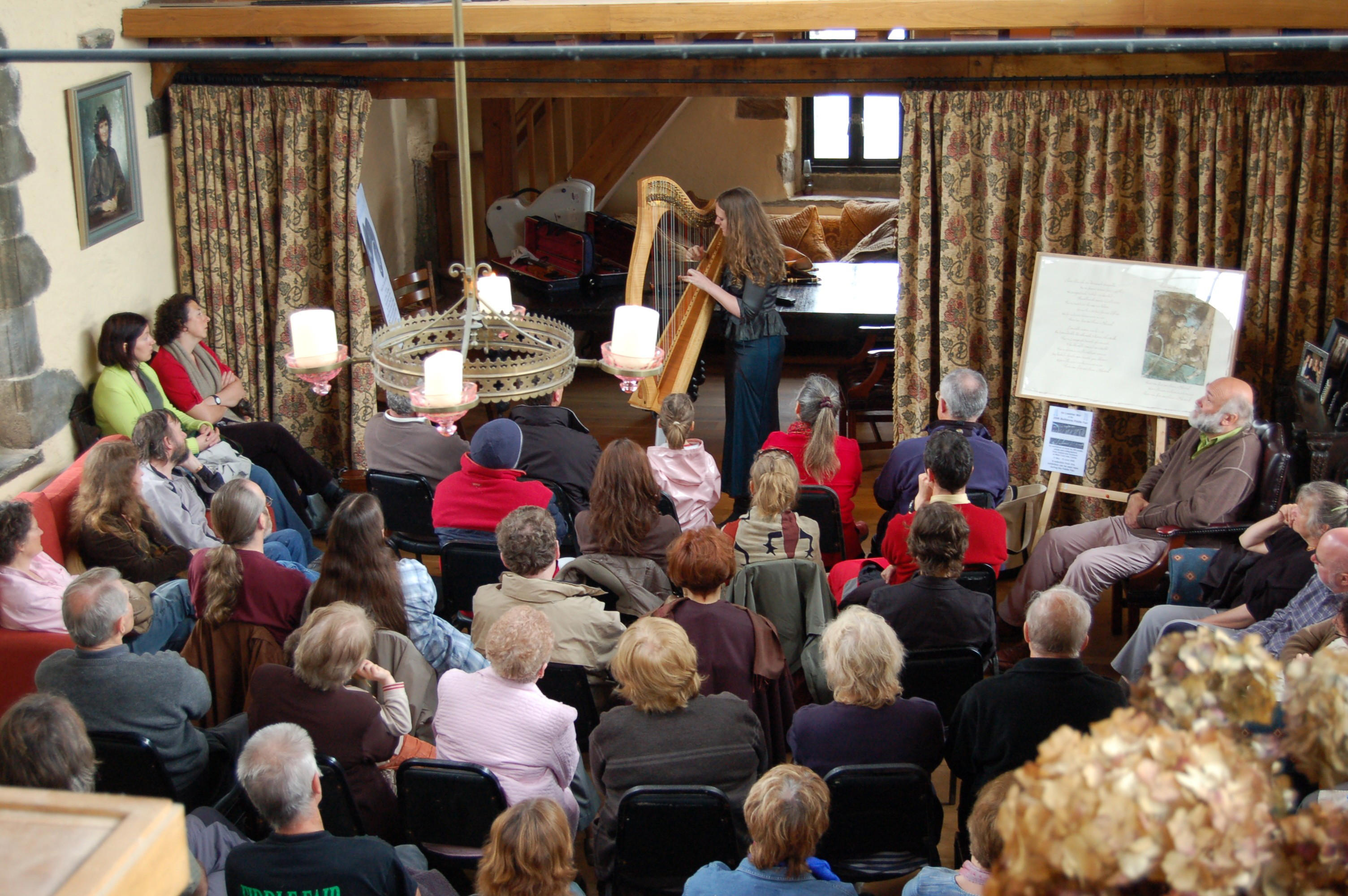 Harpist playing in the great hall