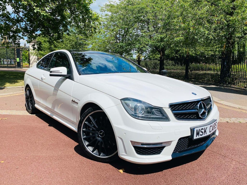 Presented in factory White with an Immaculate Ivory and Black two tone leather Interior