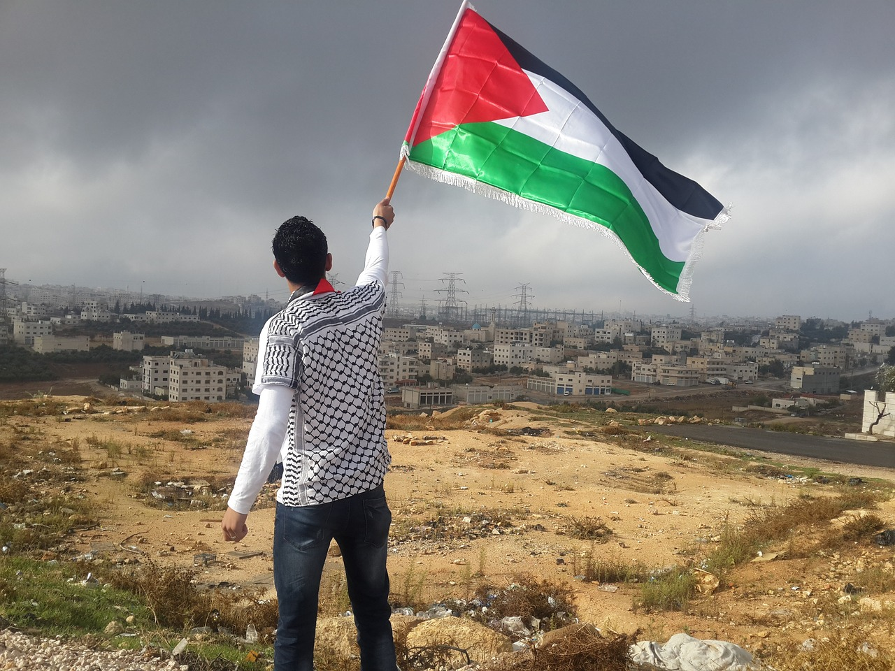 Flag-Of-Palestine-Arab-Man-Waving-1081797jpg