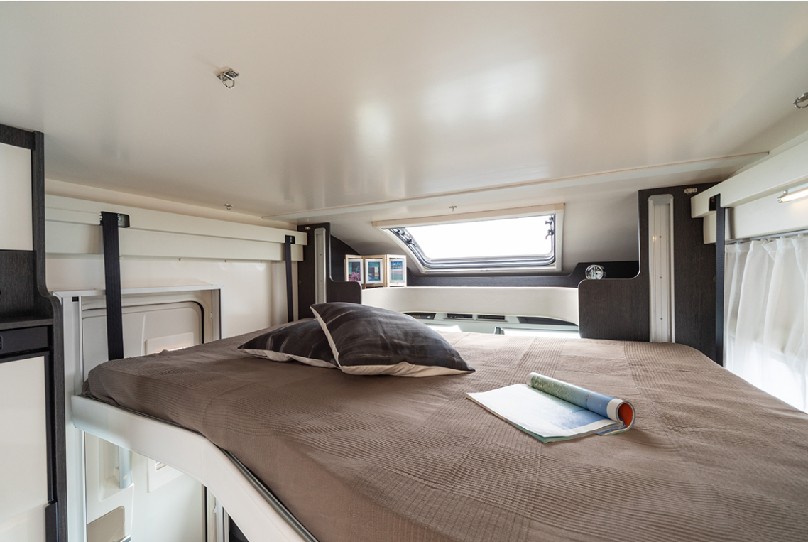 Electric drop down double bed image in main cab area