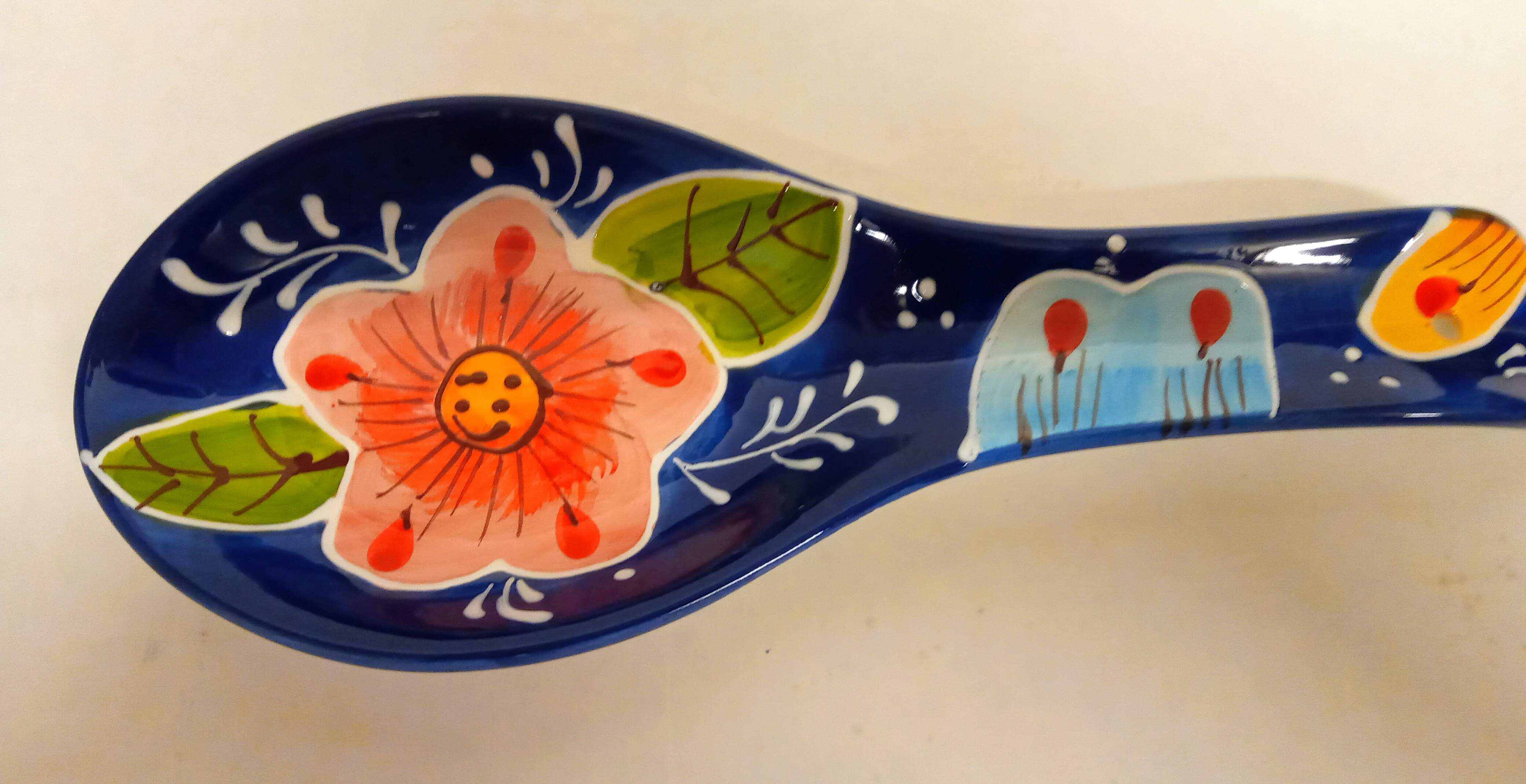 Spanish ceramic spoon rest with two fish design