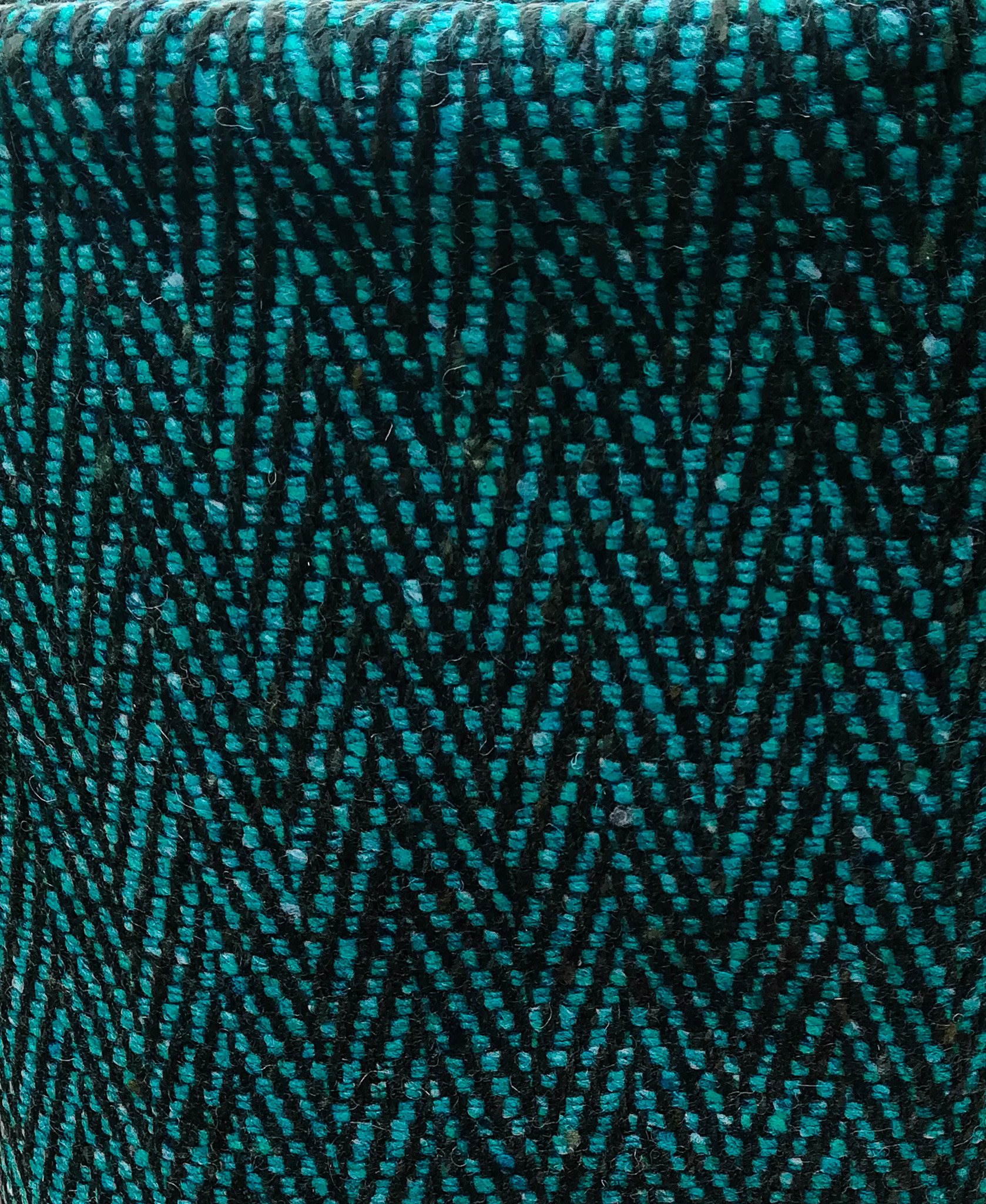 "New Herringbone Donegal Tweed by Fabric Affair:""Turquoise Black""."