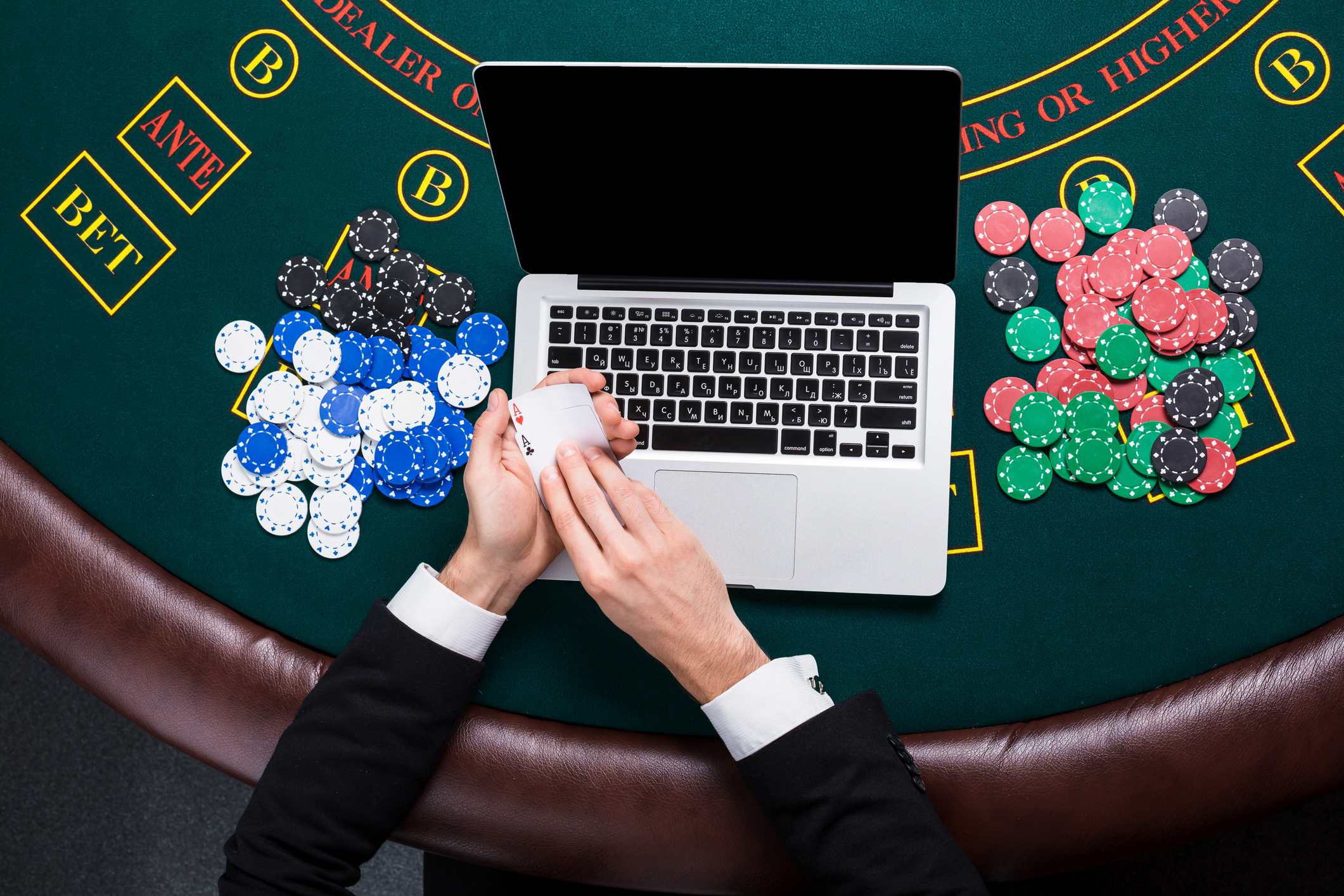 casino-online-gambling-technology-and-people-concept-close-upjpg