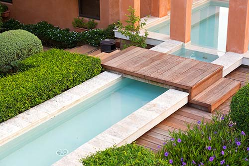 Contemporary pool garden with bridge and rill