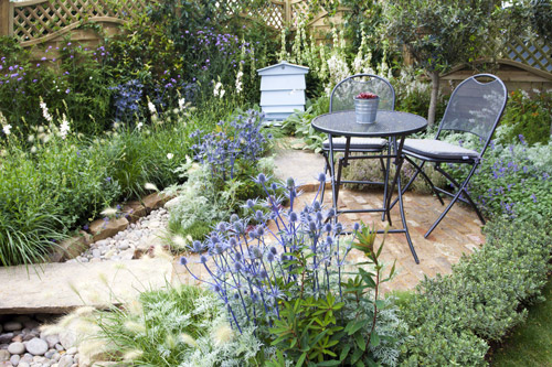 Country garden with bee hive and intimate terrace
