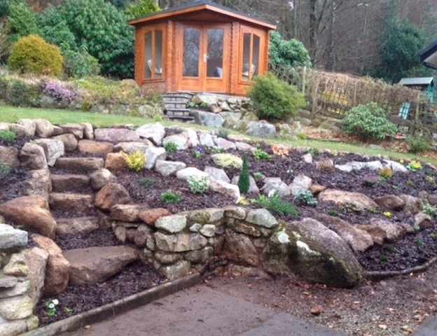 Rockery and summer house in a sloping garden, designed and built by Creative Gardens Dalbeattie