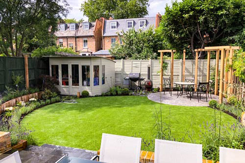 Wonderful Gardens design in Wimbledon small garden with pergola seating area