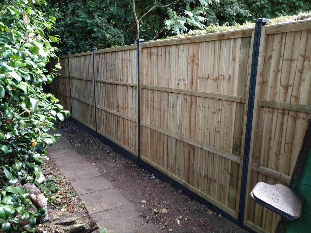 Anthracite grey steel posts on composite gravel boards.
