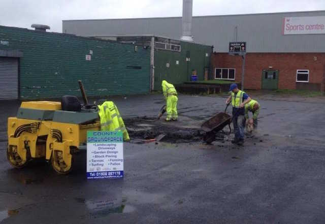 Filling in car park pot holes in a sports centre car park - County Groundforce Ltd Bilston Wolverhampton Health and Safety