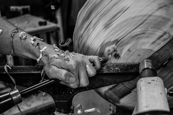 Eoghan Leadbetter Woodturner making a wooden bowl on the lathe in his studio in kilkenny, Ireland