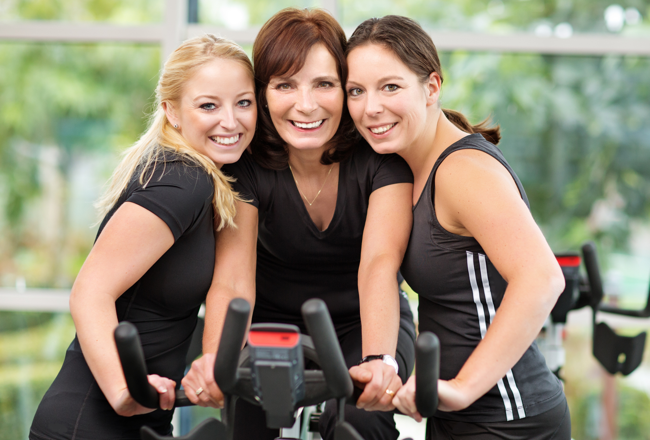 happy-mother-and-daughters-in-exercising-classjpg