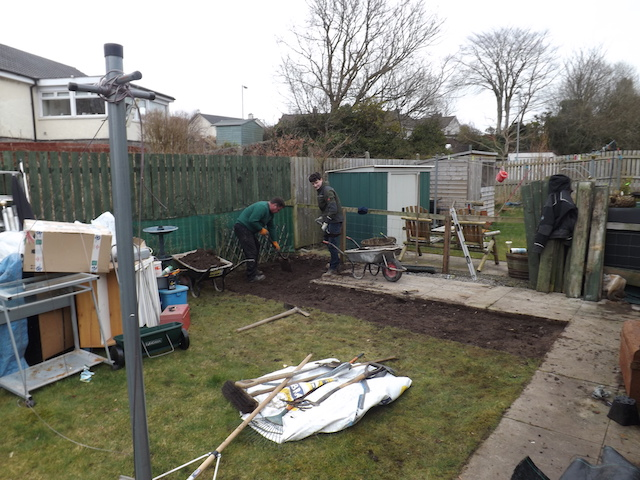 The Creative Gardens team digging out a garden to lay paving slabs for a patio