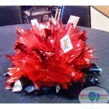 Casino themed centerpiece in red and black with playing cards