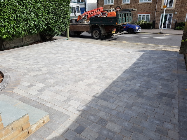 Silver Haze block pave patio and driveway with kerbed border in Egham, Surrey