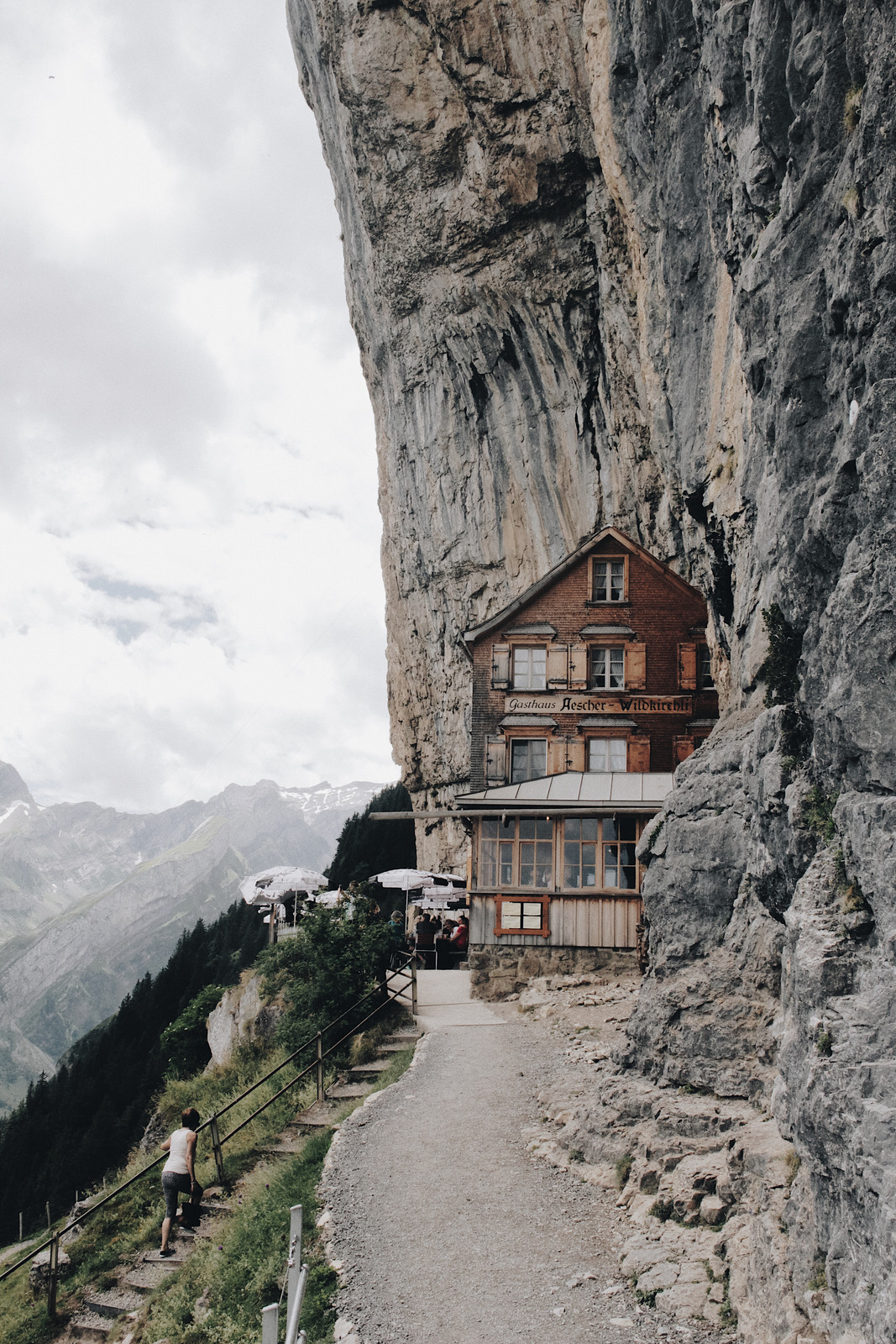 Canva - Brown Wooden House on Edge of Cliff.jpg