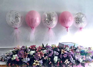 Tulle covered balloon centerpieces, confetti balloons on a stand