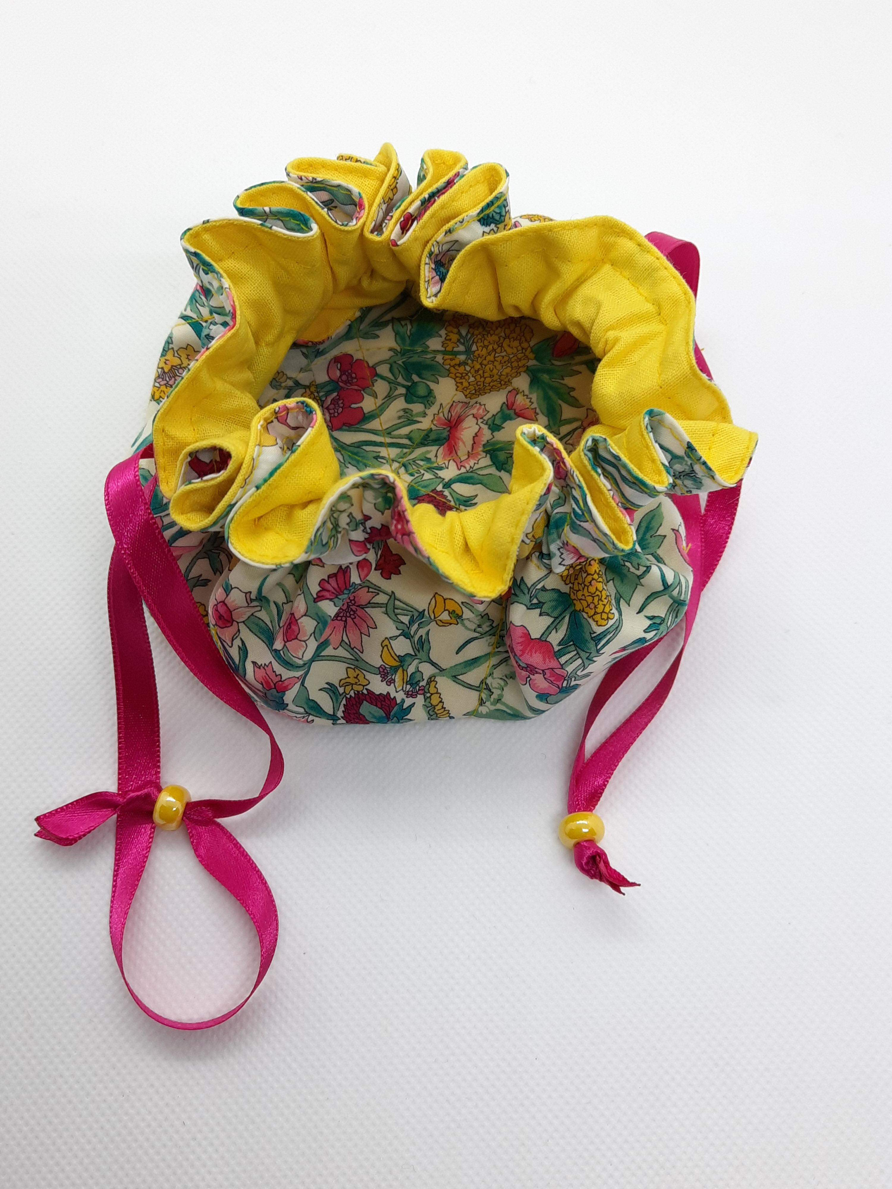 Jewellery Pouch - yellow lining, pink ribbon, yellow bead