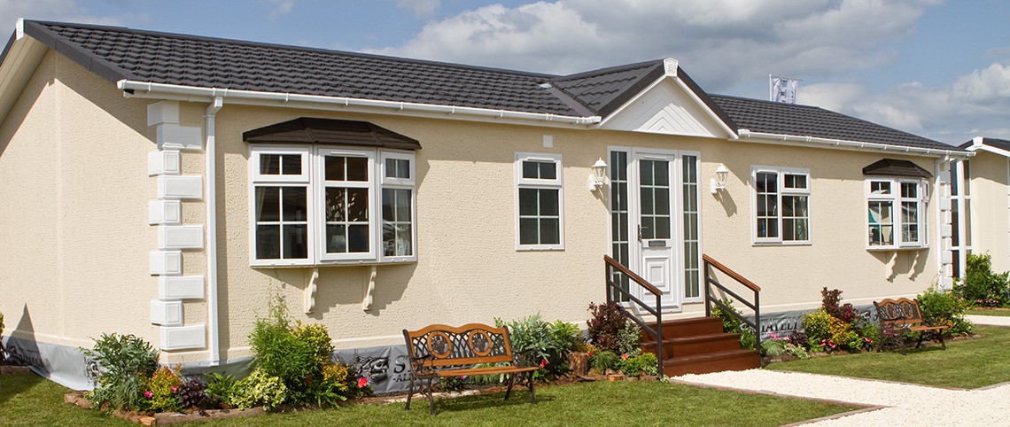 Mossband Residential Park Dumfries and Galloway, showing an example of a stylish luxury park home with full landscaping