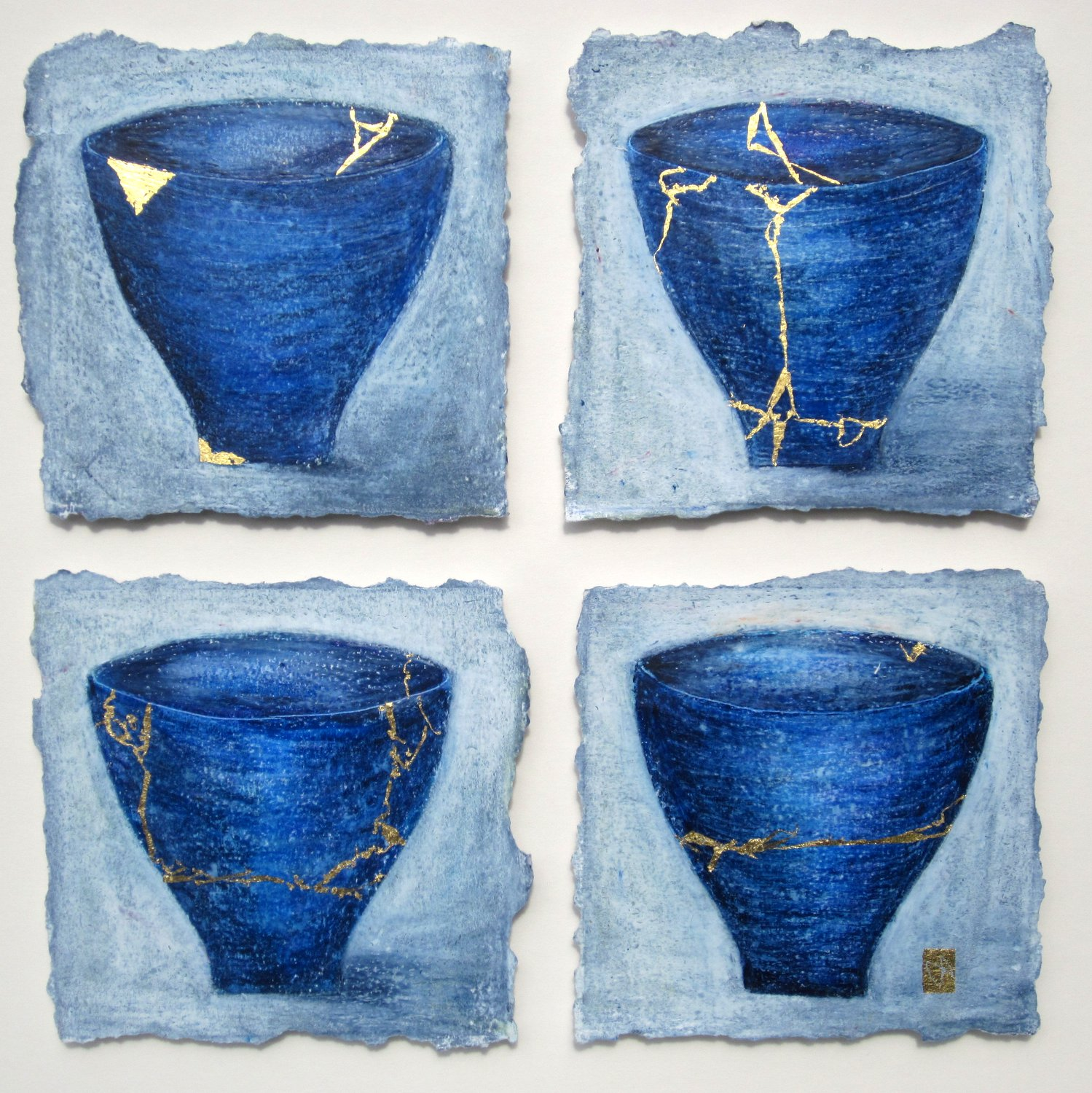 Four blue kintsugi tea bowls with gold repair