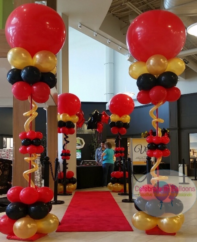 Balloon columns for casino themed party in red, black and gold