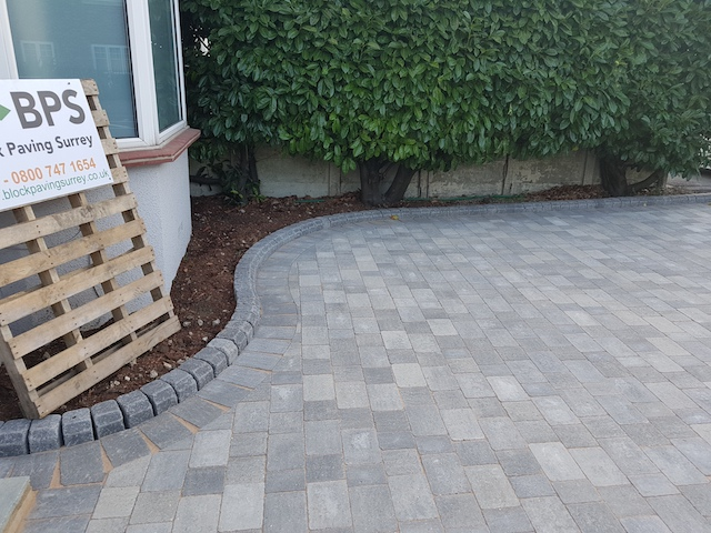 Silver Haze block pave driveway with kerbed border in Egham, Surrey