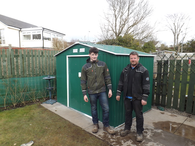 John and Murray McLeod showcasing their handiwork on the build of a metal garden shed and patio
