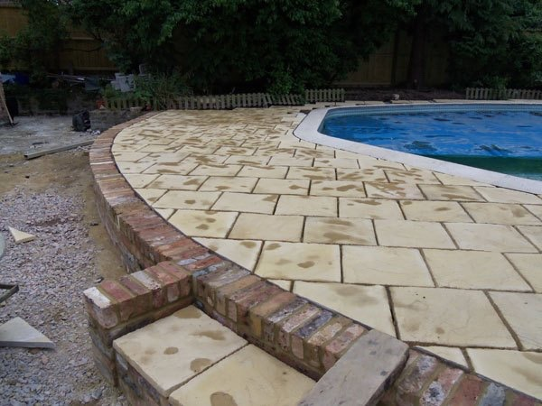 Paving around swimming pools by Block Paving Surrey Egham