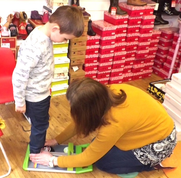 4-year-old model Marcus has his feet professionally measured at The Pied Piper