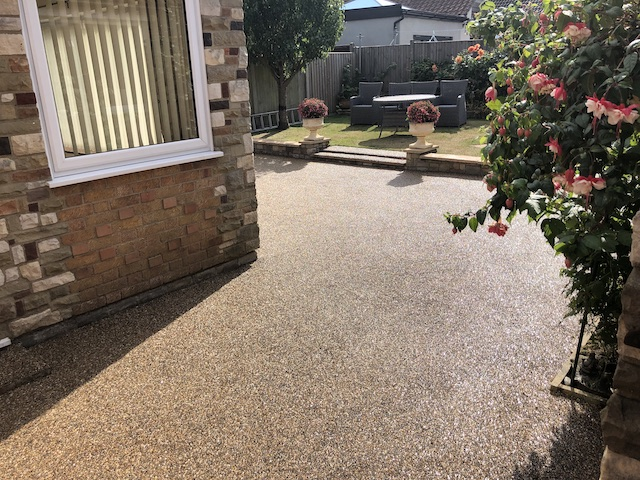 Neat resin bound surfacing in gold