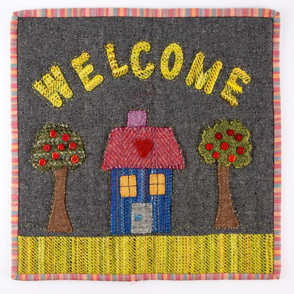 "Fabric Affair: ""Welcome tweed wall hanging""."