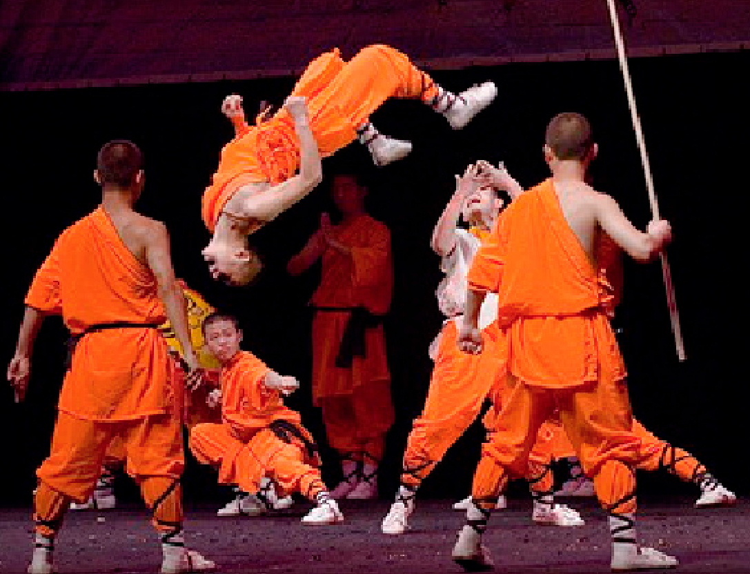 Shaolin Kung Fu practitioners leaping