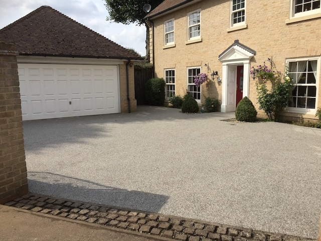 The block paving has been replaced with a resin bond surface in a lighter colour