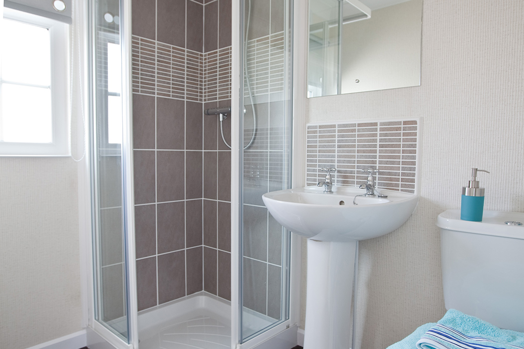 The modern shower room of a park home at Mossband Residential Park, Kirkgunzeon, Dumfries and Galloway, Scotland
