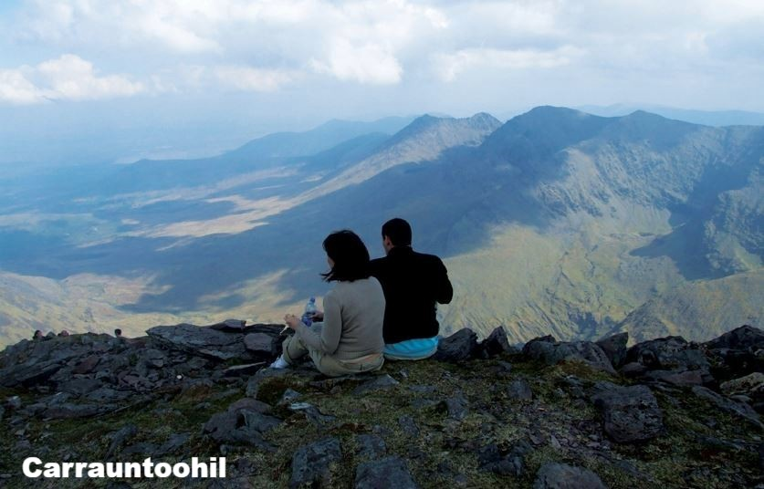Hillwalkers taking a break on Carrauntoohil,  County Kerry, Ireland