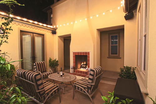 Intimate courtyard with lighting and dining area