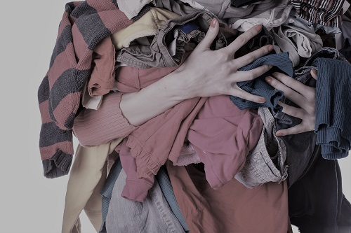 person holding a pile of laundry