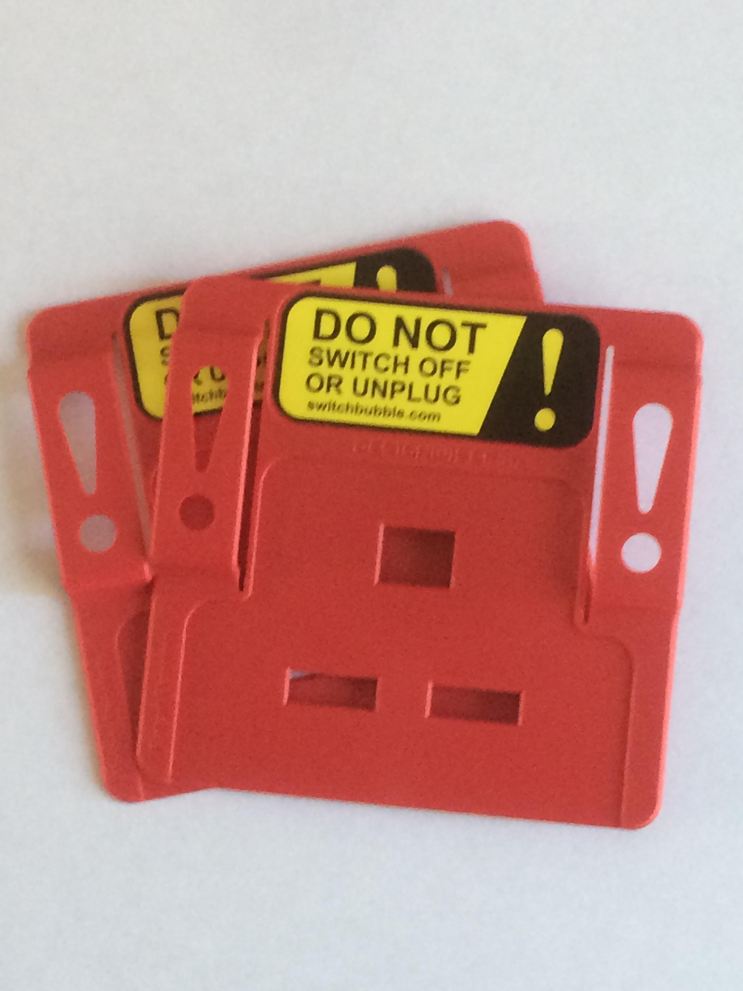 Dual pack (quantity 2) SwitchBubble Power Protectors in red. Price (inc VAT & delivery):