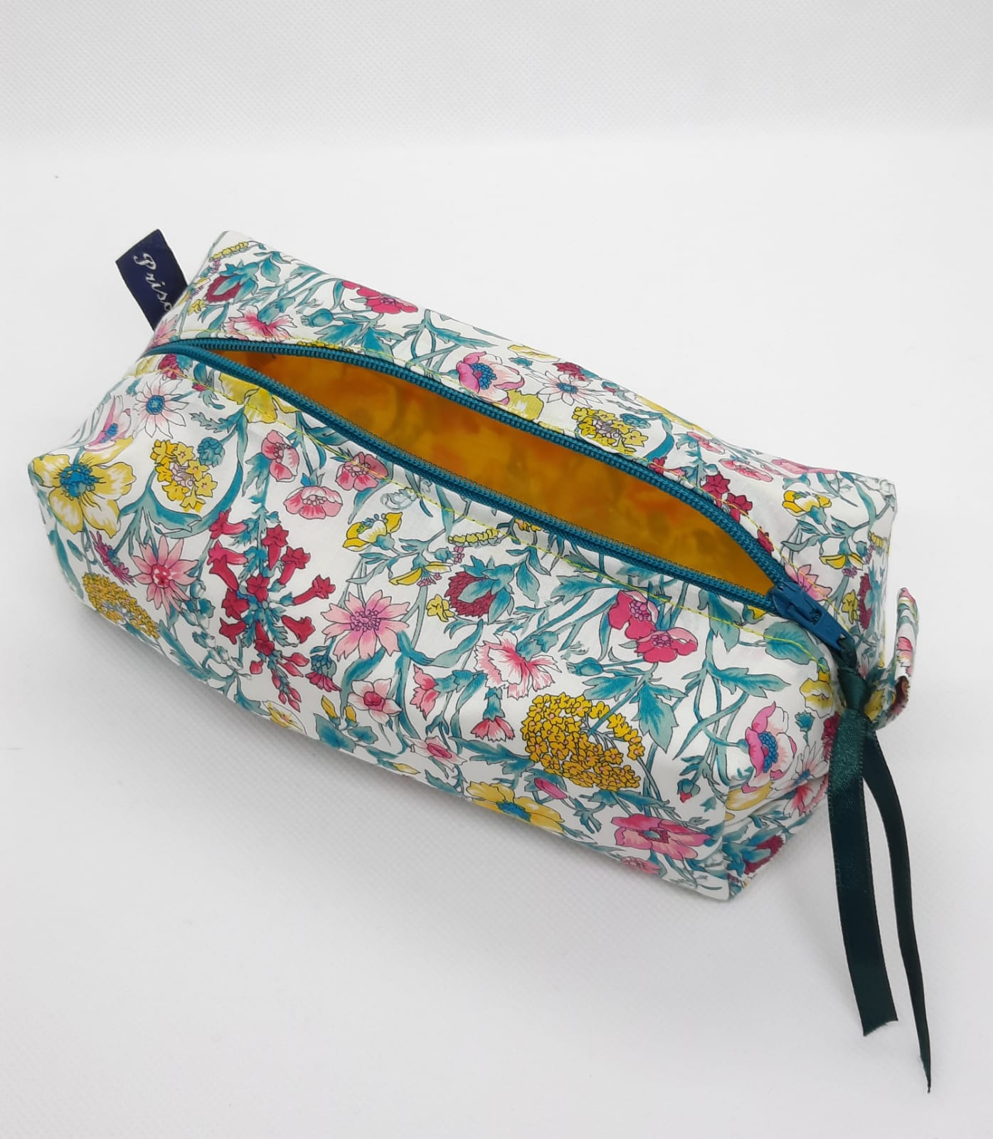 Make up bag; Liberty material on the outside; yellow spinnaker sailcloth inside th