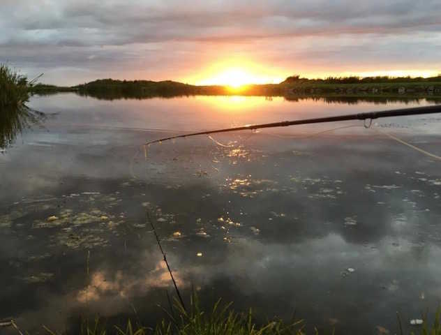 The sun sets over Glenquicken Troutmasters Fishery