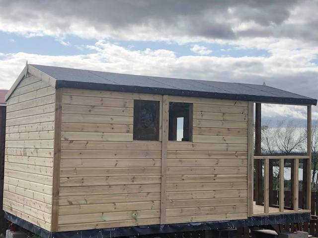 Side view of the new glamping sheds at Glenquicken, showing a view of the lochan