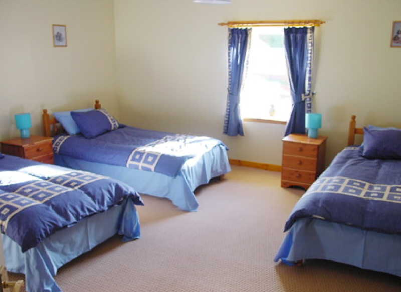 A large family bedroom at Mill Cottage Glenquicken near Newton Stewart, Dumfries and Galloway Scotland