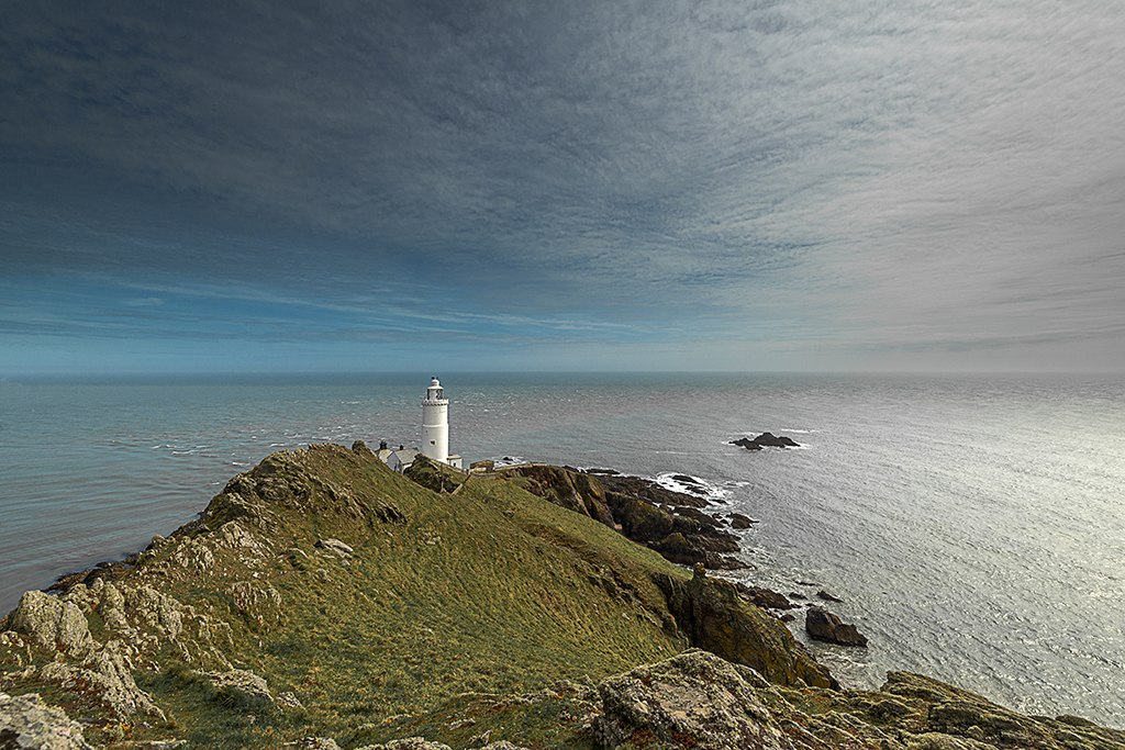 Start Point Lighthouse and black stone rocks. Stock Image ID: 2503