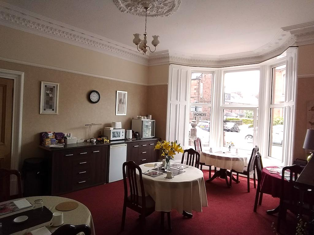 The Breakfast Room of Lindean Guest House with its large bay window looking out onto quiet Rae Street