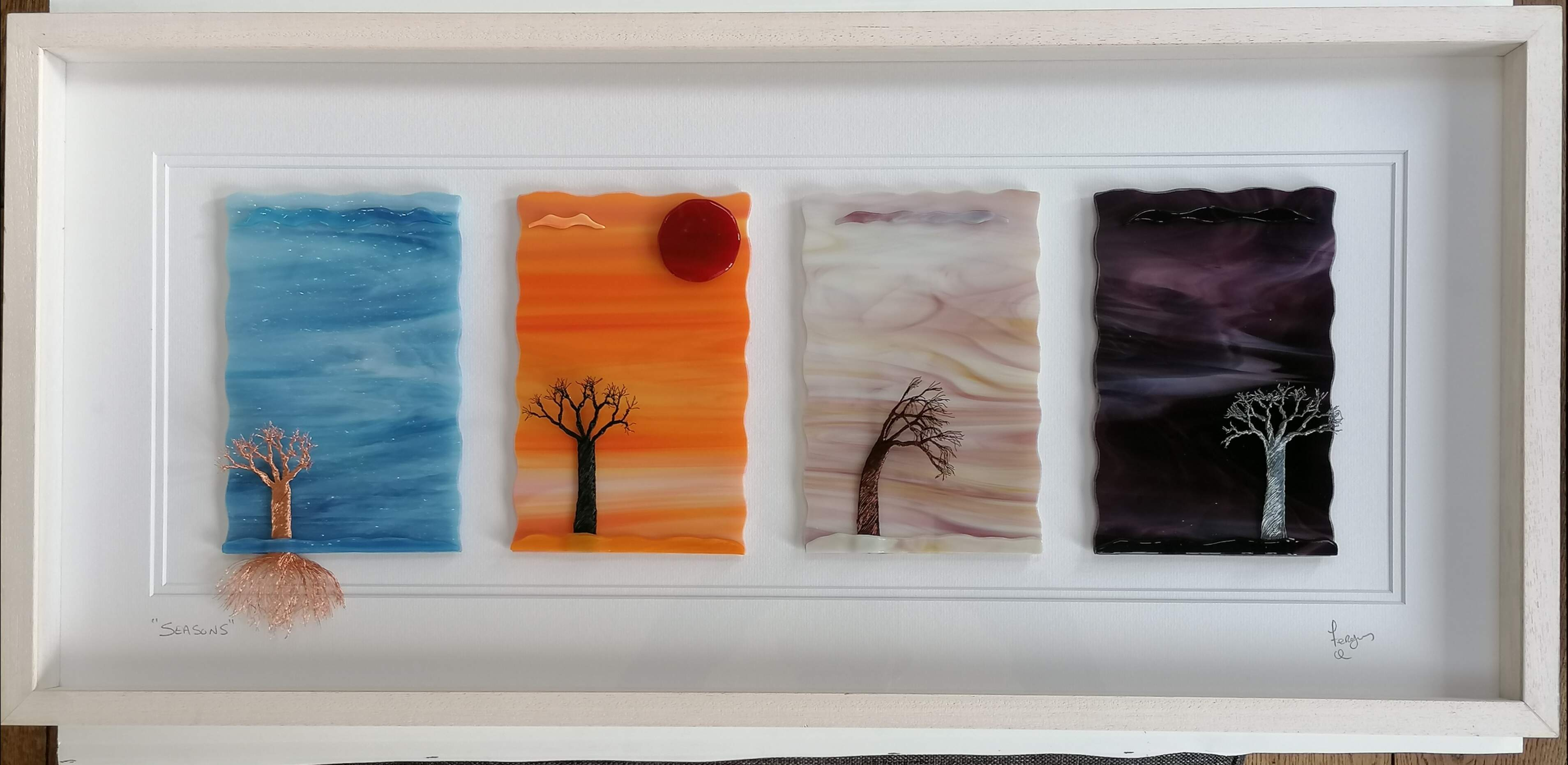 Glass Art picture displaying 4 panels representing the Seasons