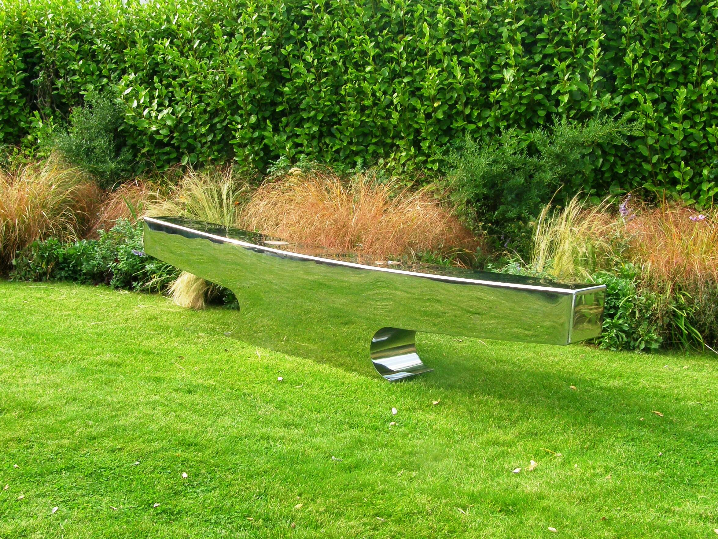 Garden colours reflecting in highly polished panels of stainless steel