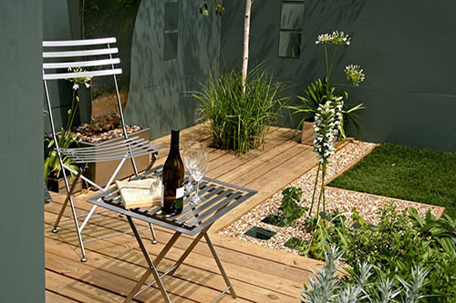 Small seating area with decking and contemporary planting