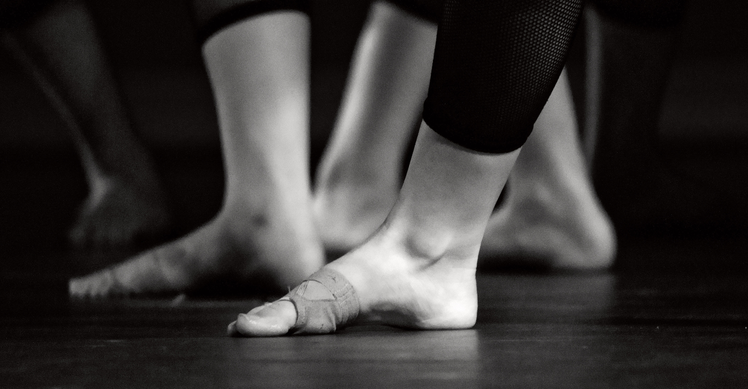 feet-of-lyrical-dancers-in-black-legginsjpg