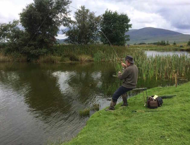 Fishing from the bank at Glenquicken Troutmasters Fishery